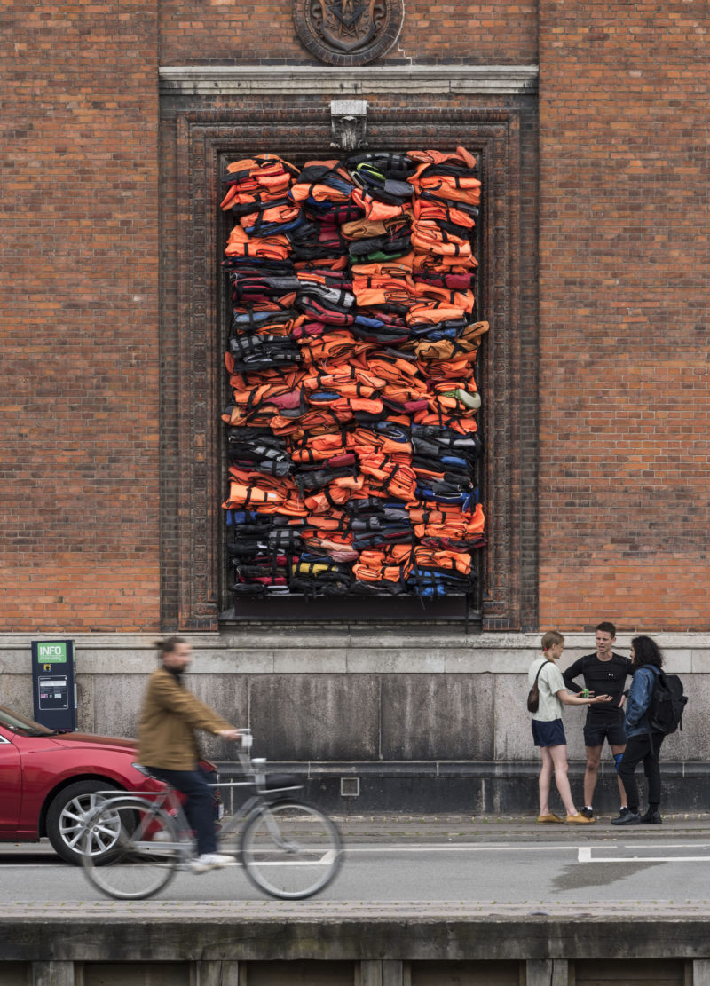 Ai Weiwei - Soleil Levant, 2017, life jackets in front of windows of facade, Kunsthal Charlottenborg, 2017, David Stjernholm.