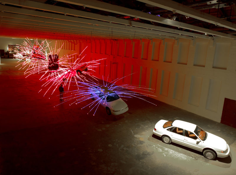 Cai Gao-Qiang – Inopportune Stage One, 2004, nine Ford Taurus cars, sequenced multichannel light tubes, installation view at Mass MoCA, December 1, 2004 – October 30, 2005