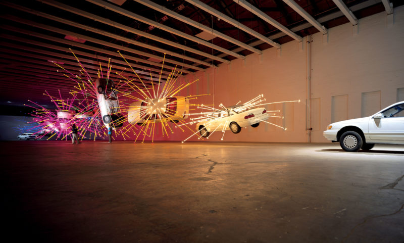 Cai Guo-Qiang – Inopportune Stage One, 2004, nine Ford Taurus cars, sequenced multichannel light tubes, installation view at Mass MoCA, December 1, 2004 – October 30, 2005