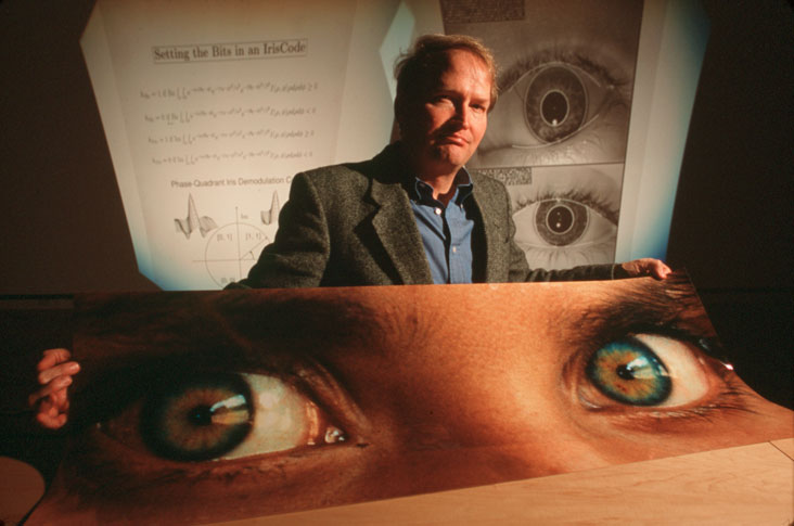 John Daugman from Cambridge University, the inventor of automatic iris recognition, with photo print of eyes of the adult Sharbat Gula