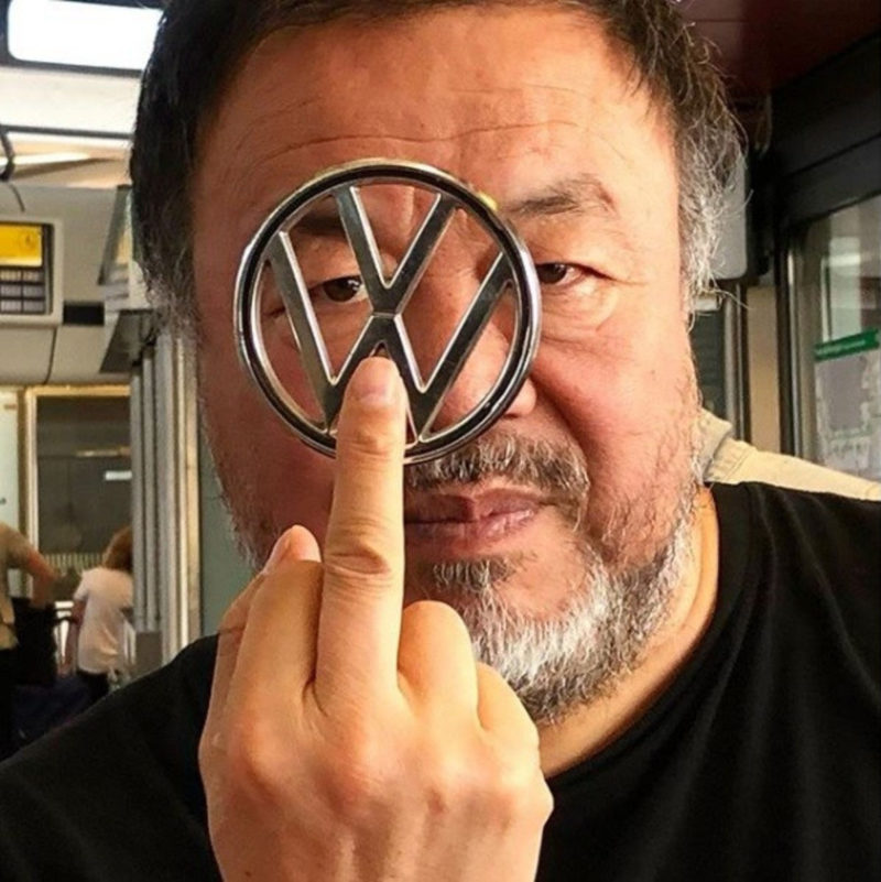 Portrait of Ai Weiwei with Volkswagen logo