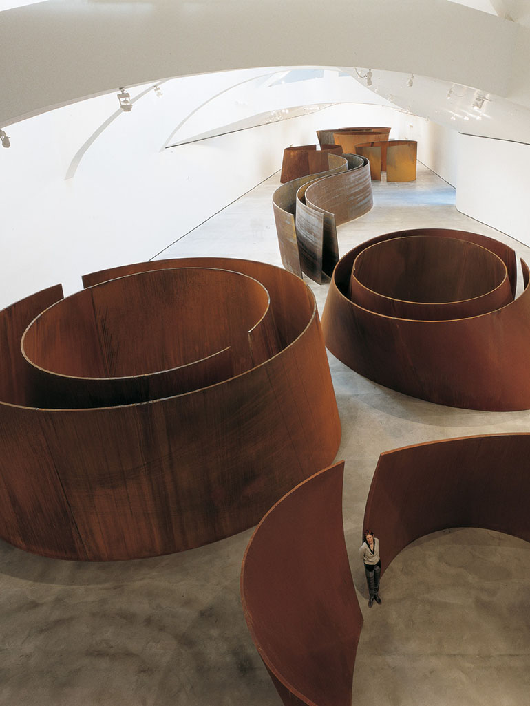 These are Richard Serra's Torqued Ellipses