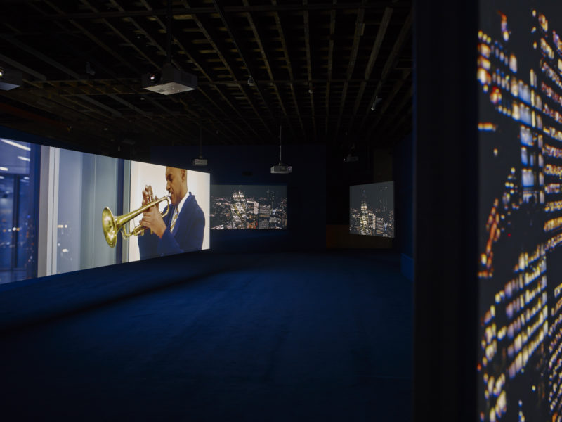Colin Salmon in Isaac Julien's - Playtime, 2014, Seven screen ultra high definition video installation with 7.1 surround sound, 66 min 57 sec, Victoria Miro, London, 2014