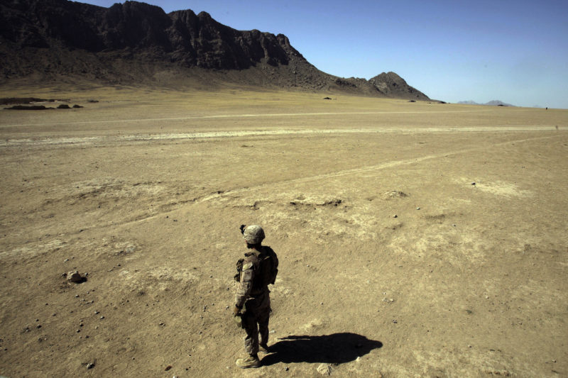David Guttenfelder – Afghanistan - In Helmand Province, Afghanistan, a US marine surveys the barren landscape during a patrol