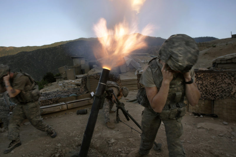 David Guttenfelder – Afghanistan - Soldiers from the U.S. Army First Battalion, 26th Infantry fire mortars from the Korengal Outpost