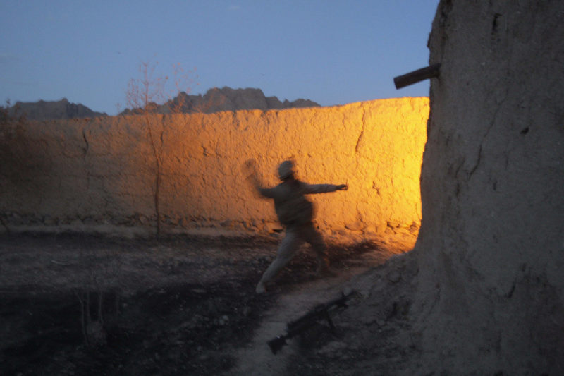 David Guttenfelder – Afghanistan - U.S Marine Daniel Hinther of Helena, Montana, with the 2nd MEB, 2nd Battalion, 3rd Marines throws a hand grenade during close quarter battle with insurgent fighters inside a mud walled compound near Now Zad in Afghanistan's Helmand province Saturday June 20, 2009.