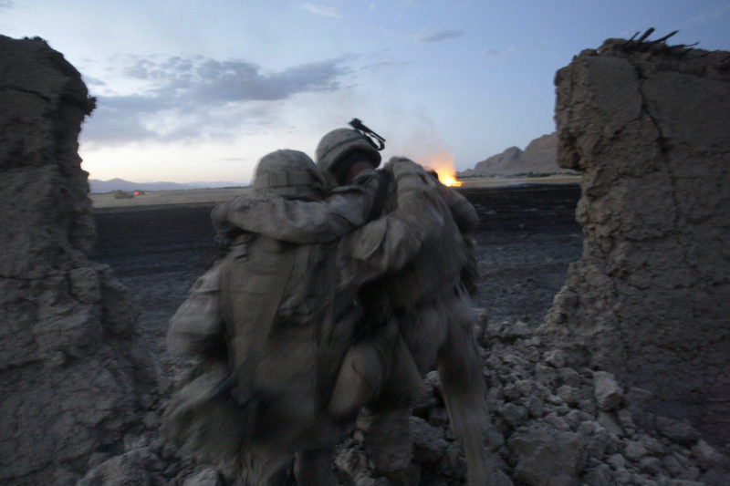 David Guttenfelder – Afghanistan - U.S Marine John Daly, right, of Collingdale, Pa. and from the 2nd MEB, 2nd Battalion, 3rd Marines is helped by a fellow Marine after injuring his ankle in a fall when insurgent fighters opened fire on him and his squad inside a mud walled compound during a gun battle near Now Zad in Afghanistan's Helmand province Saturday June 20, 2009