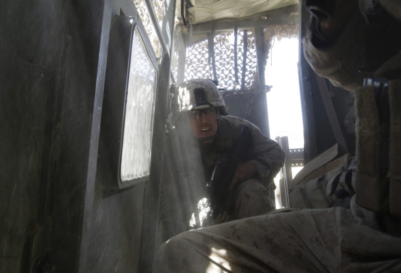 David Guttenfelder – Afghanistan - U.S Marines Staff Sgt. Luke Medlin of Indiana and from the 2nd MEB, 2nd Battalion, 3rd Marines takes cover as a mortar fired by insurgent fighters explodes next to his vehicle near Now Zad in Afghanistan's Helmand province Saturday June 20, 2009.