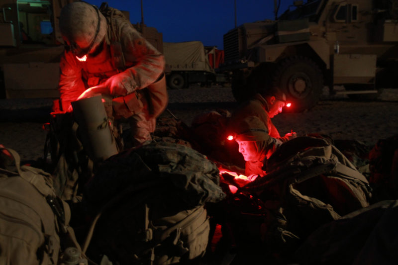 David Guttenfelder – Afghanistan - U.S. Marines from 3rd Battalion, 6th Marine Regiment read and pack their gear under red light head lamps at a forward operating campsite in Marjah in Afghanistan's Helmand province on Thursday February 18, 2010.