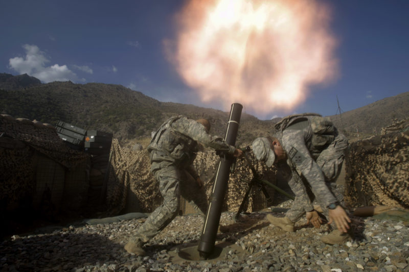 David Guttenfelder – Afghanistan - U.S. soldiers fire mortars at enemy firing positions from a base in the Pech River Valley in Afghanistan's Kunar province in 2009.