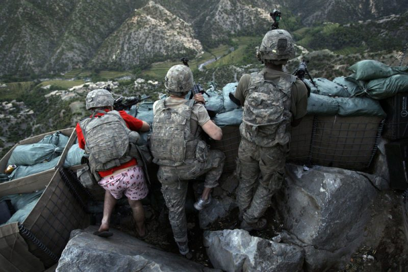 David Guttenfelder – Afghanistan - US Army soldiers take defensive positions and return fire against insurgents behind a rocky cliff in the Korengal Valley of Afghanistan's Kunar Province.