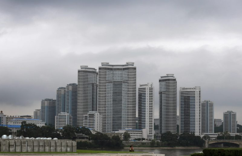 David Guttenfelder - A North Korean soldier stands against a complex of high rise apartment buildings in the Mansudae district downtown Pyongyang on July 21, 2013. The country is preparing to mark the 60th anniversary of the end of the Korean War