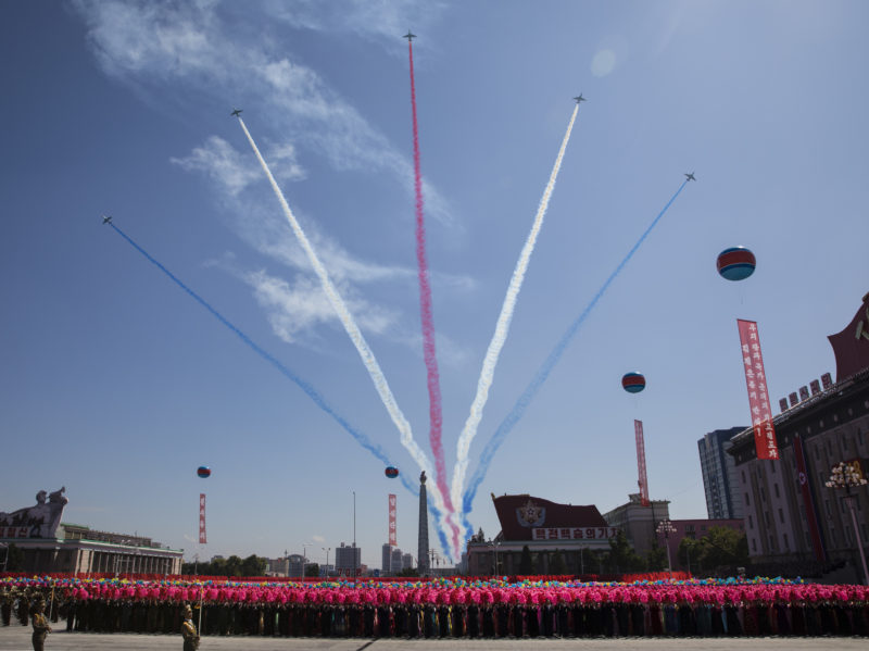David Guttenfelder - North Korean airplanes fly over Kim Il Sung Square in Pyongyang during a mass military parade to mark its 70th anniversary as a nation