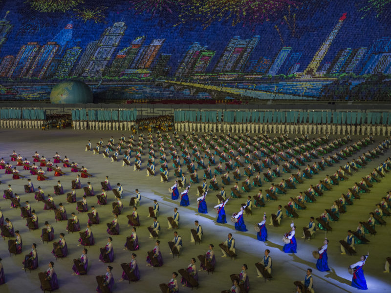 David Guttenfelder - North Korean citizens use colored cards to create a giant mosaic depicting the city of Pyongyang