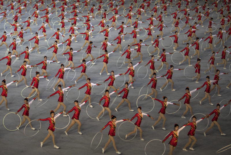 David Guttenfelder - North Korean women twirl hoops during a debut of a new mass games event to mark the 70th anniversary of the founding of the nation