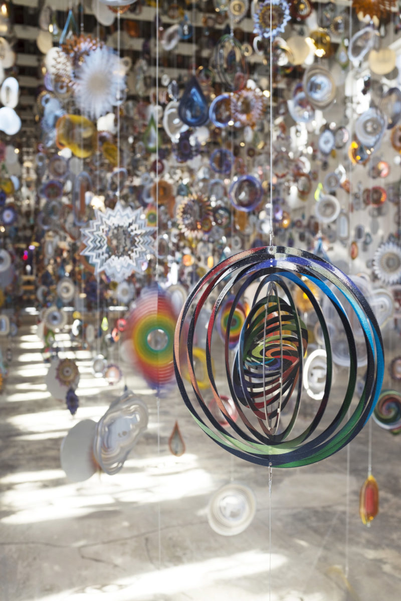 Detail of Nick Cave - Kinetic Spinner Forest, 16,000 hanging mobiles made from metallic spinning garden ornaments