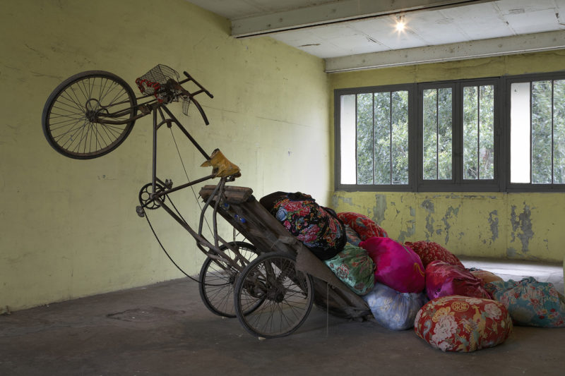 Kimsooja - Bottari Tricycle, 2009, used Chinese tricycle, bedcovers and clothes, 295 x 190 cm, Installation view Continua Gallery, Le Moulin 2009