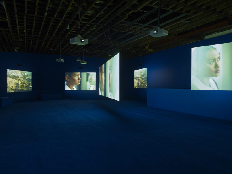 Mercedes Cabral in Isaac Julien's Playtime, 2014, Seven screen ultra high definition video installation with 7.1 surround sound, 66 min 57 sec, Victoria Miro, London, 2014