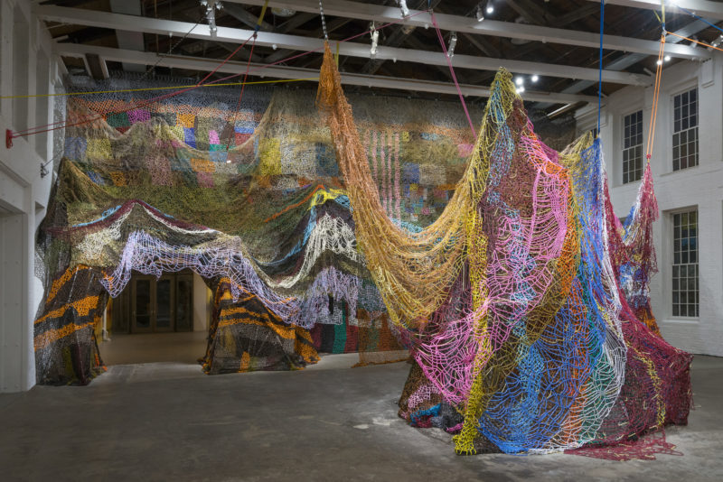 Nick Cave - Beaded Cliff Wall, millions of pony beads threaded onto shoelaces by hand