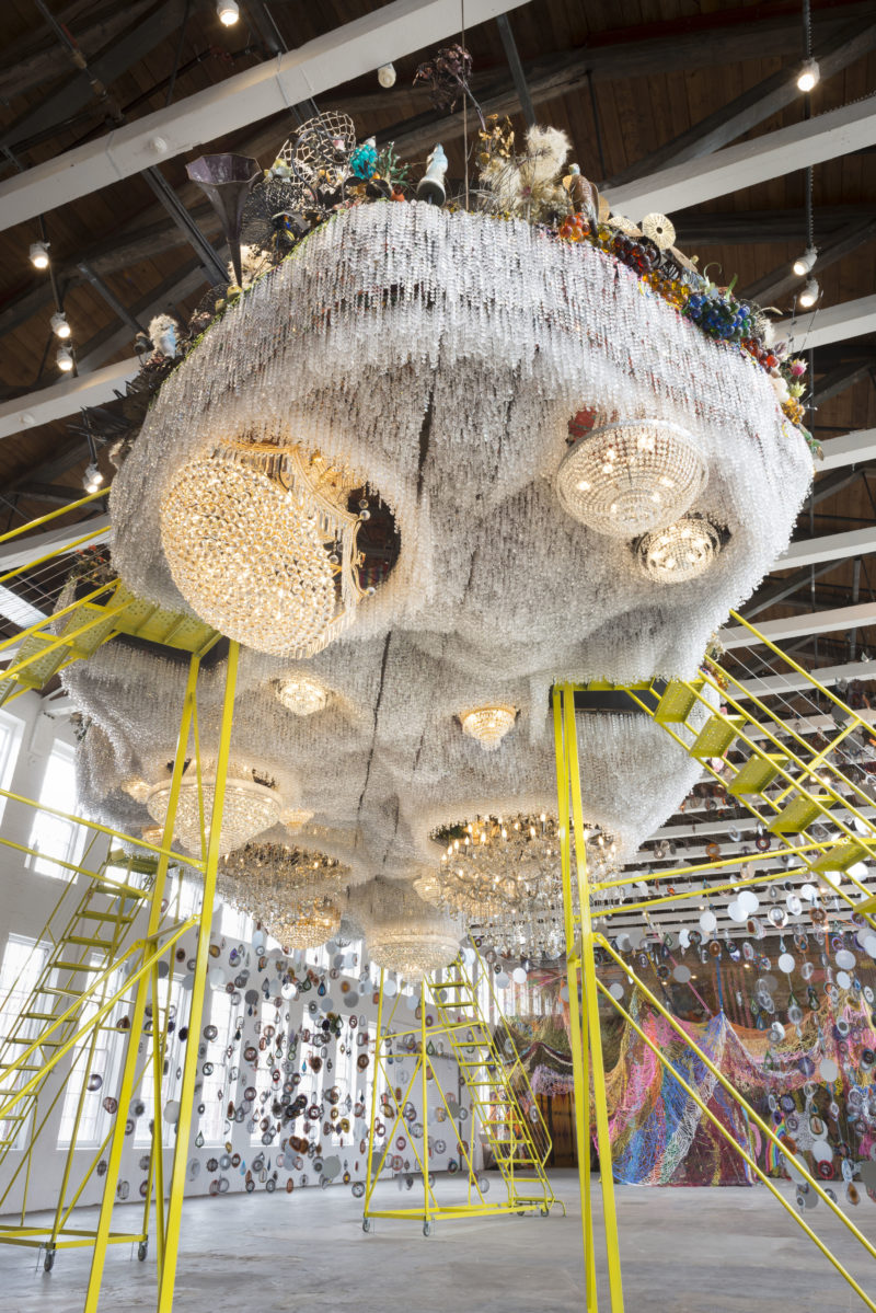 Nick Cave - Crystal Cloudscape, thousands of crystals, beads, found objects and a few chandeliers, 12m long, 6m wide, with four ladders to view artwork from top level, MASS MoCA, 15 Oct 2016 - 4 Sep 2017