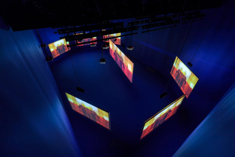 Simon de Pury in Isaac Julien's Playtime, 2014, Seven screen ultra high definition video installation with 7.1 surround sound, 66 min 57 sec, Platform-L Contemporary Art Center, Seoul, 2017