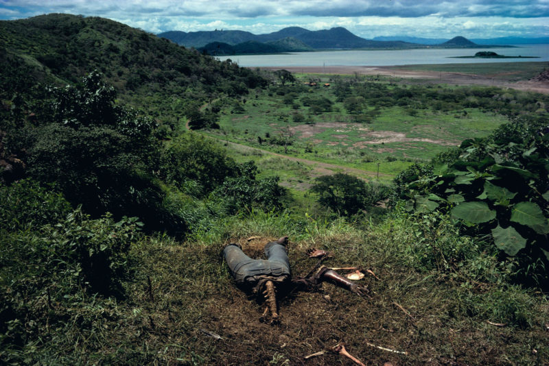 Susan Meiselas - Cuesta del Plomo, showing a body on a hillside outside Managua, a well known site of many assassinations carried out by the National Guard, Managua, Nicaragua, 1981