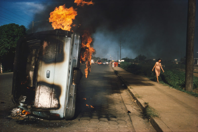 Susan Meiselas - The car of a Somoza informer burning in Managua, Nicaragua
