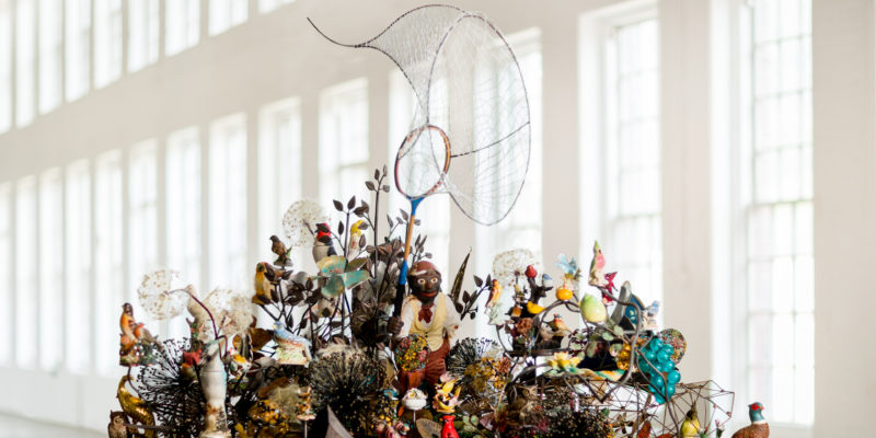 Top view of Nick Cave – Crystal Cloudscape, thousands of crystals, beads, found objects and a few chandeliers, 12m long, 6m wide, with four ladders to view artwork from top level