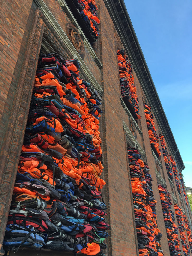 Ai Weiwei – Soleil Levant, 2017, life jackets in front of windows of facade, Kunsthal Charlottenborg, 2017