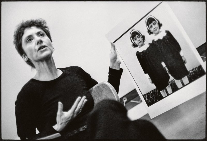 Diane Arbus with her photograph Identical Twins during a lecture at the Rhode Island School of Design in 1970