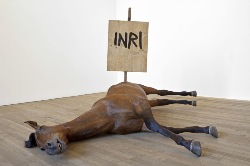 Maurizio Cattelan - Untitled (Inri), 2009, taxidermized horse, glass, wood, 158.5 x 200 x 190 cm (5.2 x 6.6 x 6.2 ft), installation view of Pop Life, Tate Modern, London, 2009