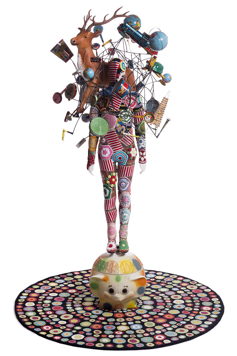 Nick Cave - Soundsuit, 2015, vintage toys, globes, wire, fabric, rug, metal, mannequin, 117 x 50 in