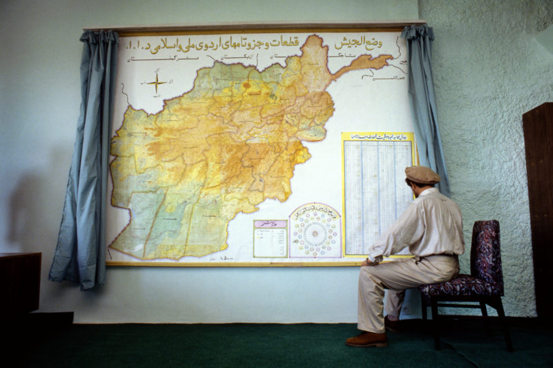 Stephen Dupont – Former Defense Minister Ahmad Shah Massoud in front of a map of the country in his office in Kabul, Afghanistan, 1995