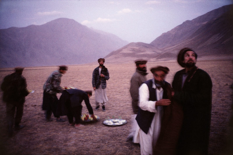 Stephen Dupont – In the Fayzabad Mountains, Afghanistan, in 1998. Commander Massoud, with his friends in the early evening, just after the prayer.