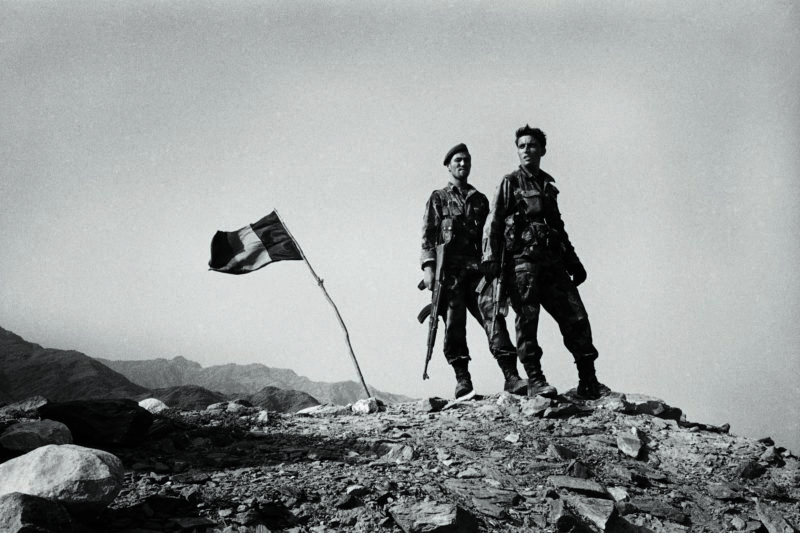 Stephen Dupont - Afghan Army soldiers patrol near the village of Narang with their American allies, Afghanistan, 2005