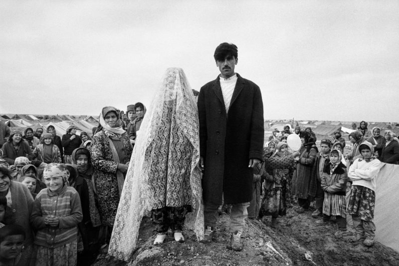 Stephen Dupont - In the 1993 Saki Tajik refugee camp in Afghanistan. A couple of Tajiks are having their picture taken to celebrate their wedding, Mazar-I-Sharif, 1993