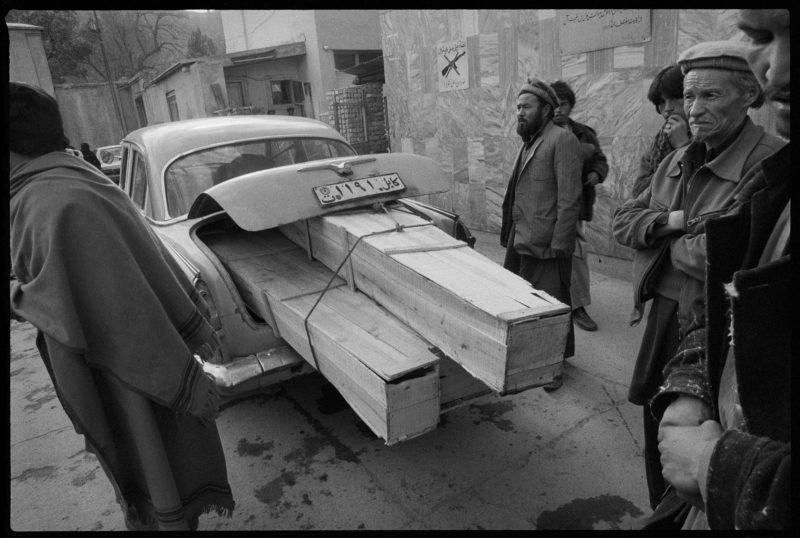 Stephen Dupont - One car, three coffins. The entrance to Jamhuriat Hospital at the time of the occupation during the Afghan Civil War, Afghanistan, 1993