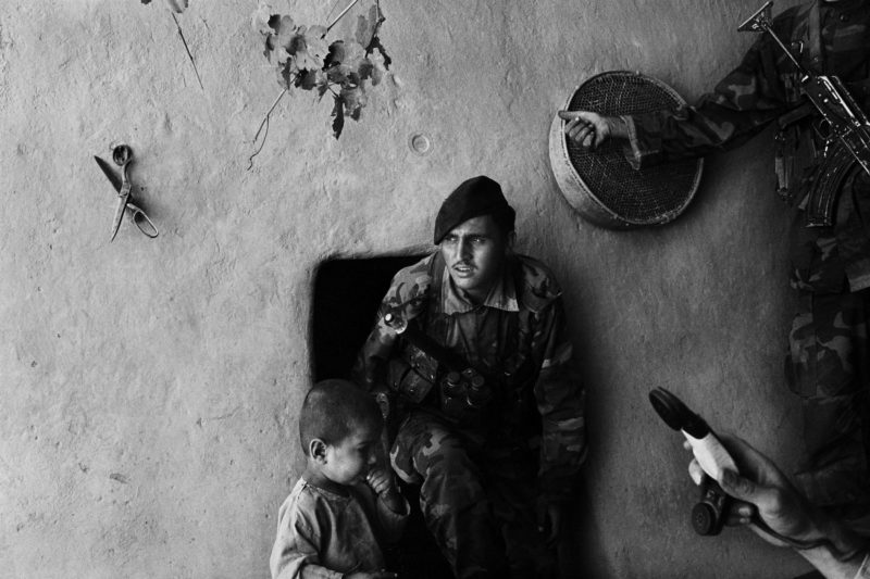 Stephen Dupont - Soldiers leave a home in Gonbaz village near Kandahar after searching for hidden Taliban fighters and guns, Afghanistan, 2005