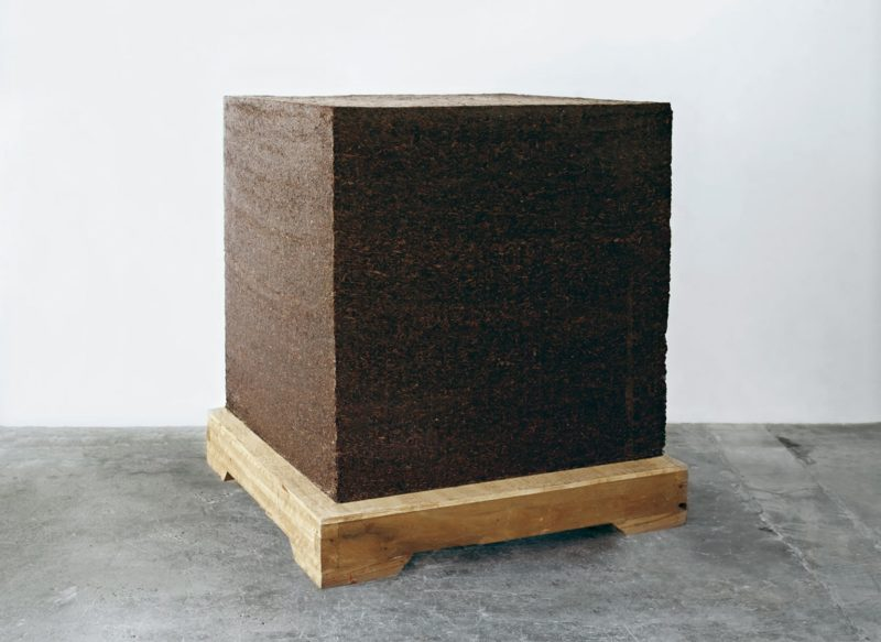 Ai Weiwei - Ton of Tea, 2005, Pu'er tea leaves from Yunnan province with wooden base, 100 x 100 x 100 cm (39 1/2 x 39 1/2 x 39 1/2 in)