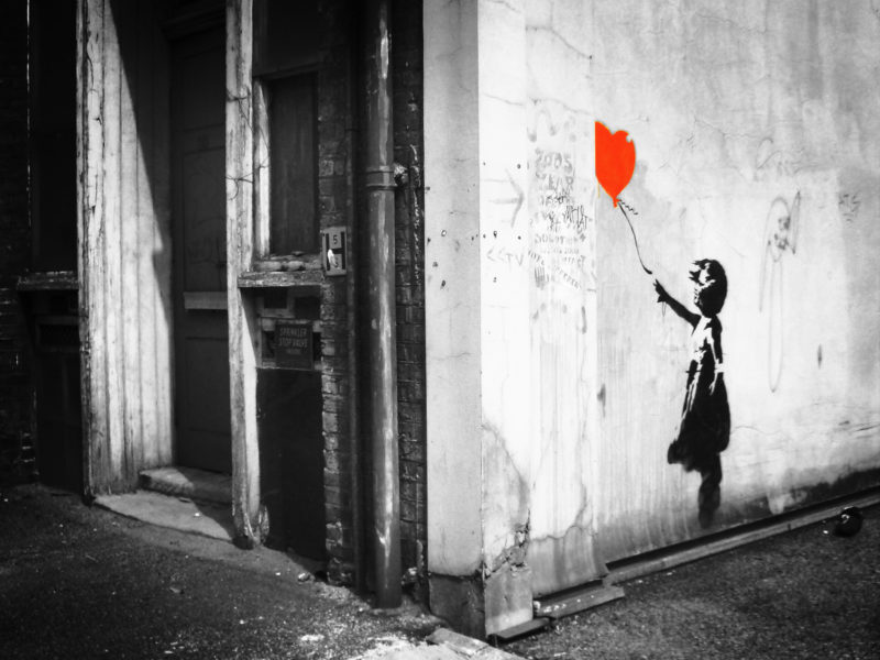 Banksy - Girl and balloon on Vestry street just off Old Street, London UK