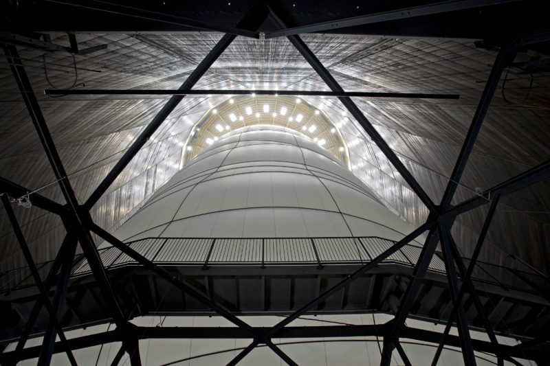 Christo - Big Air Package, 2010, 20,350 sqm of semitransparent polyester fabric, 4 500 m of polypropylene rope, inflated 90 m tall, 50 m wide, 177,000 cubic meter, 5,300 kg, Gasometer Oberhausen, Germany, 2010-2013