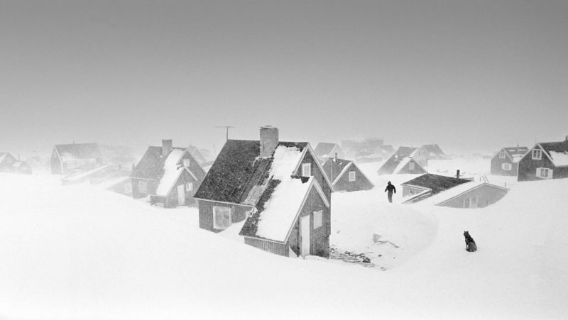 Ragnar Axelsson - Last Days of the Arctic - Blizzard in Ittoqqortoormiit village on the east coast of Greenland