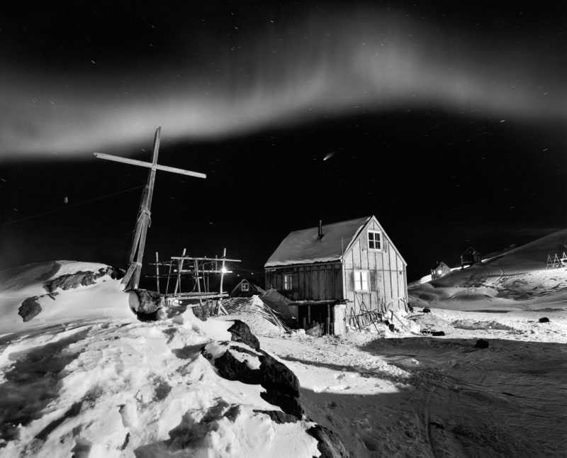 Ragnar Axelsson - Last Days of the Arctic - Comet Hale-Bop in the sky with dancing northern lights in the village of Tinniteqilaaq on the east coast of Greenland