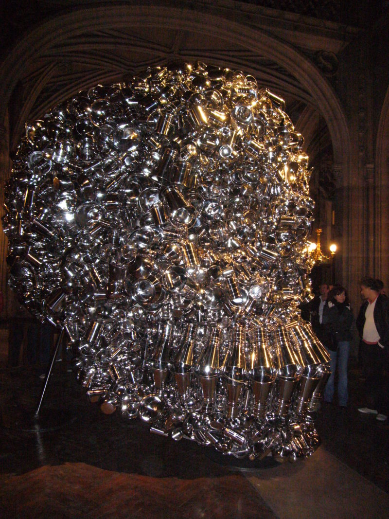 Subodh Gupta – Very Hungry God, 2006, hundreds of stainless steel containers, 360 x 280 x 330 cm, installation view, Nuit blanche, Église St Bernard, Paris, 2006