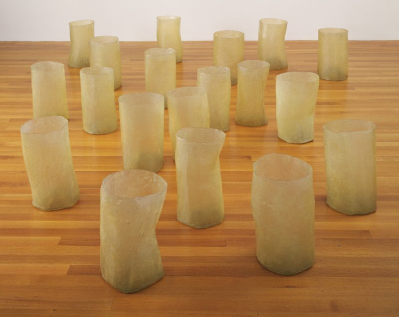 Eva Hesse - Repetition Nineteen III, 1968, Fiberglass and polyester resin, nineteen units, Each 19 to 20 1/4 (48 to 51 cm) x 11 to 12 3/4 (27.8 to 32.2 cm) in diameter