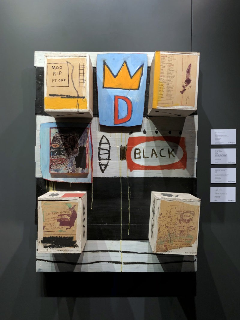 Jean-Michel Basquiat - Black, 1986, acrylic, oilstick, xerox collage and wood collage on panel, 126 x 93 x 29 cm (50 x 36 x 11 in), installation view, Sotheby's Hong Kong