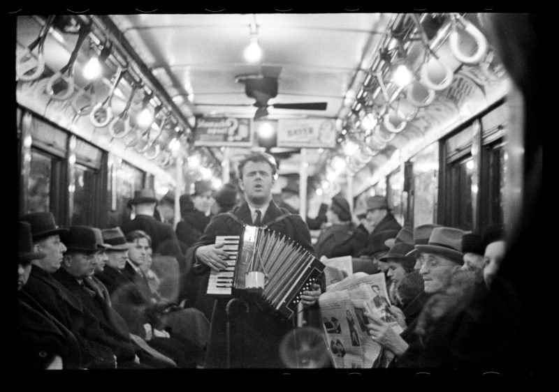 Walker Evans – View Down Subway Car with Accordionist Performing in Aisle, New York City, from Many Are Called
