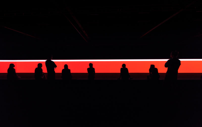Carsten Nicolai - unicolor, 2014, DLP-projectors, DMX-LED lights, projection screen, mirrors, computer, sound, bench with loudspeakers