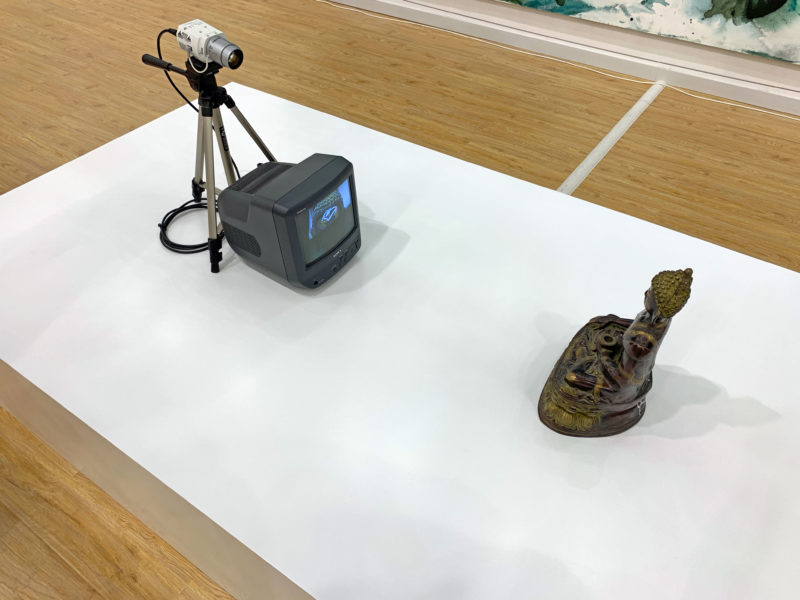 Nam June Paik - TV Buddha, 2002, Bronze, paint, television monitor, closed-circuit video camera, tripod, transformer, adaptors, television:video cable and extension cords
