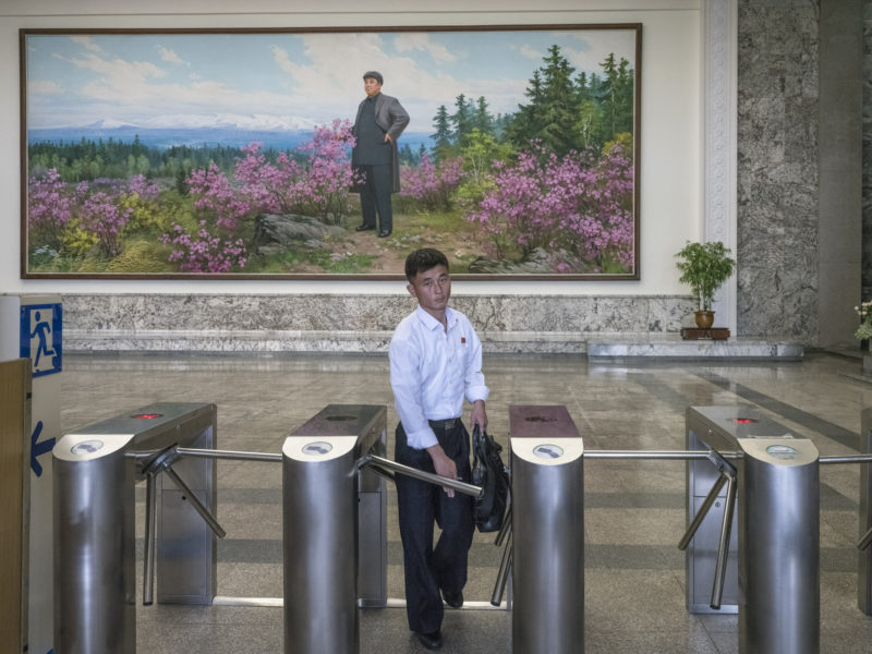 Carl De Keyzer - Entry to the Grand People's Study House, Pyongyang. The painting in the background depicts President Kim Il Sung at Mt. Paekdu. 5 June 2017 3:00 PM